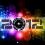 9888540-suggestive-2012-new-year-celebration-background-with-glitter-and-rainbow-colours-ideal-for-nightlife